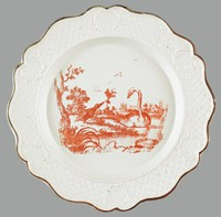 """Staffordshire transfer-printed salt-glazed stoneware scalloped plate, printed in red with a fable subject """"The Raven and the Swan"""" within a diaper and cartouche molded border and brown-edged rim"""