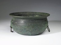 A large bronze bowl with two ring handles