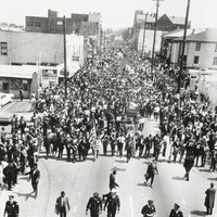 The black-and-white photograph shows a funeral procession for Dr. Martin Luther King in Atlanta.