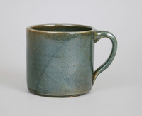Cup or Mug, Miller Pottery, Alabama, Perry County, stoneware with Albany or Michigan slip and white feldspar glaze, blue pieces tinted with cobalt