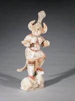 Fierce guardian figure standing on a bull (?)