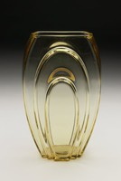 Topaz-colored biface glass vase, with two concentric parabolas on each face, tapered to base.