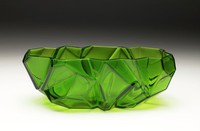 Oblong glass bowl in deep emerald green with irregular facets