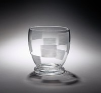 Transparent glass vase with wheel-cut decoration consisting of horizontal lines in an ascending-descending checkerboard pattern.