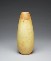 Tapered cylindrical vase with speckled glaze graduating in color from a light tan on the body of the vessel to a darker brown at the rim.