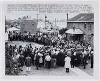 """Press print with caption """"SLP031306-3/13/65-SELMA, ALA.: This is a general view of the courtyard confrontation between a column of civil rights marchers led by priests and nuns and Selma city police. The priests ran through the courtyard after Selma public safety director Wilson Baker halted their march, but police quickly cut them off. UNITED PRESS INTERNATIONAL TELEPHOTO -fwl"""""""