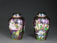 Pair of ginger shaped jars with covers