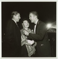 """Ronald and Nancy Reagan being interviewed by Jack Linkletter at the premiere of """"Sayonara"""""""