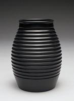 Black basalt vase of ovoid shape, Keith Murray shape 3870, with engine-turned ribbing on the body.