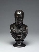 Portrait bust of Sir Isaac Newton on round socle, wearing an open collar and drapery.