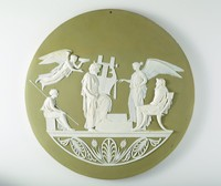 Large round green jasper plaque with white relief scene of the Apotheosis of Homer. The relief represents the deification of the Greek poet Homer, author of the Odyssey.