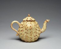 Tan and brown agate teapot with cover, originally broken in several pieces