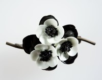 Wedgwood Bone china flowers and metal brooch with white flowers against black leaves.