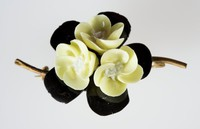 Wedgwood bone china and metal flower brooch with three yellow flowers against a black leaves