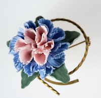 Wedgwood bone china floral brooch with a blue and pink flower against green leaves on a metal mount