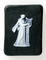 Square black jasper plaque with white relief of Terpsichore, the muse of choral dance is represented holding a lyre and plectrum, lab trial