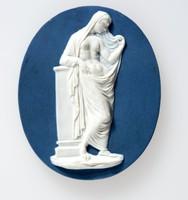 Oval dark blue jasper medallion with white relief of a Vestal, or a Priestess of the Goddess Vesta.