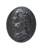 Small oval portrait medallion of black basalt with the bust of Benjamin Franklin (1706-1790), American statesman and printer, to left, with the name FRANKLIN below the truncation.