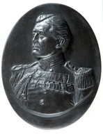 Oval basalt medallion with portrait of David Beatty, 1st Earl Beatty (1871-1936) born in Nantwich Stapeley he grew to become a important Royal Navy officer fighting in the Madhist war and the Boxer Rebellion and later becoming the commander of the 1st Battlecruiser Squadron at the Battle of Jutland in 1916. He was awarded many high ranking medals and became a Member of the Order of Merit and given the title of Earl  Beatty in 1919.