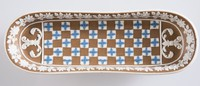 Tri-color jasper diceware (brown, white and blue) footed pen tray, one foot chipped with loss and a few losses to relief inside.