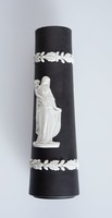 Cylindrical black jasper beer/ale pump column with white relief decoration of a classical lady with stick and peacock and on the other side a classical female carrying a cornucopia of flowers with a border at the top and bottom of oak leaves and acorns