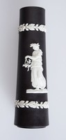Cylindrical black jasper beer/ale pump column with white relief decoration of a woman with a wreath and a bird on her finger and on the other side a lady with a twig.