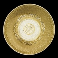 Bowl with molded floarl design around lower part of cavetto, molded flower in well.