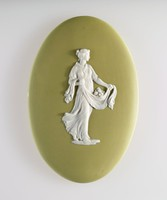 Oval green jasper plaque with white relief of a classical women carrying a basket of fruit