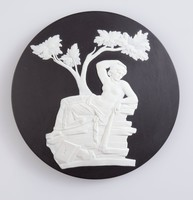 Round black jasper trial plaque with white relief of a reclining female figure taken from the Portland vase