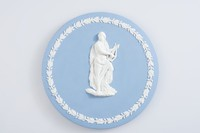 """Round blue jasper plaque with white relief of Apollo holding Lyre and oak leaf and acorn border, in pencil on back """"BRITISH FILM ACADEMY """"OSCAR""""/WHEN PRESENTED IS INSCRIBED IN GOLD/""""BRITISH FILM ACADEMY AWARD"""" +  YEAR"""". These plaques were presented between 1953 and 1968"""