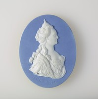 """Oval blue jasper medallion with white relief profile portrait of Catherine II (The Great), (1729-1796), was Empress of Russia from 1762 until 1796, the country's longest-ruling female leader and arguably the most renowned (although Peter the Great was the only Tsar officially designated as """"The Great""""[citation needed]). She came to power following a coup d'état when her husband, Peter III, was assassinated. Russia was revitalised under her reign, growing larger as well as stronger in military terms and becoming recognised as one of the great powers of Europe."""