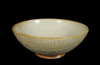 Bowl with incised lines on exterior to suggest fluting or carved petals.