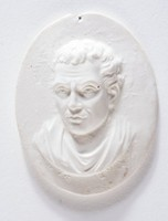 Oval medallion with portrait of an unidentified classical male facing left.