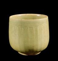 Beaker with carved lotus-petal exterior, brown wash on base.