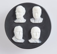 Black jasper button with white relief portraits of four martyred presidents (Lincoln, Kennedy, Grafield and McKinley) with signature facsimiles beneath each. Made by Marie La Barre Bennett. Marie created studio art pottery between 1953 and her death in 1969 after which all of her moulds were destroyed.