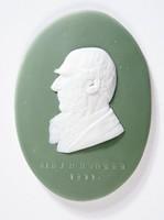 Oval dark green jasper medallion with white relief profile portrait of Sr. J. D. Hooker, 1897