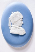 """Oval blue medallion with white relief profile portrait of Rousseau (1712-1778) facing right, Rousseau was a Francophone Genevan philosopher, writer and composer in the 18th century. His political philosophy influenced the Enlightenment in France and across Europe, as well as aspects of the French Revolution and the overall development of modern political and educational thought. """"Julie, or the New Heloise"""" was of importance to the development of pre-romanticism and romanticism in fiction. In addition, during the period of the French Revolution, Rousseau was the most popular of the French philosophers among members of the Jacobin Club."""