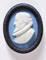 Oval tri-color jasper (black, blue, and white) medallion with white relief profile portrait of Miguel de Cervantes Saavedra, with black relief laurel leaf self-frame