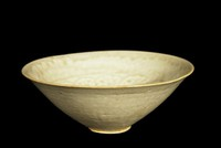 Bowl with molded clouds beneath a squared-spiral band.