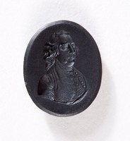 Oval black basalt intaglio with three-quarter portrait of man