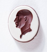 Oval brwon and white jasper intaglio with profile portrait of Scipio Africanus with cross-shaped wound on head