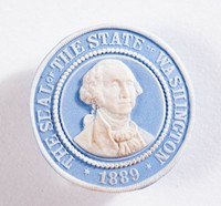 """Round blue jasper button with white relief """"THE SEAL OF THE STATE OF WASHINGTON 1889"""" and relief portrait of George Washington"""