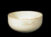 Bowl with daubs of brown underglaze iron decoration.