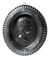 Oval basalt medallion with profile portrait of W. Stukeley (1687-1765) facing right with integral moulded frame