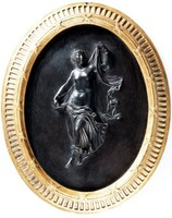 Oval basalt medallion with Herculaneum dancer, with gilt self-frame