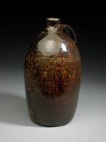 Jug with one strap-handle, dark brown glaze