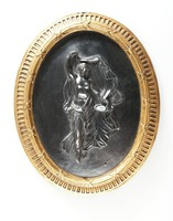 Oval basalt medallion with Herculaneum dancer relief, with gilt self-frame