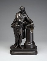 """Figure of the poet John Milton standing at a podium on a rectangular base in contemporary dress with drapery, holding in his left hand a scroll upon which a text from his """"Paradise Lost"""" in gilt reading, """" ....just and righteous. Sufficient to have stood, though free to fall."""""""