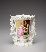 """A mold-formed cottage-type vase with central cartouche featuring a polychrome domestic genre scene.  A woman in a pink dress, standing at left, cranks a serinette [French for """"little canary""""], a small barrel organ used to teach songs to canaries.  The a birdcage, housing the canary, hangs above the table, upon which rests both the serinette, and a blue vase contain pink flowers.  Beside the table, a grey cat sits upon a wooden chair with green upholstery. This was also the subject of a 1751 painting by Jean-Siméon Chardin (1699 - 1779) entitled  """"La serinette,"""" now at the Louvre."""