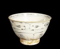 Bowl with vegetal sprays, chrysanthemums, and lappets painted in underglaze-blue cobalt-oxide, brown wash on base.